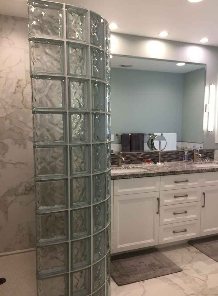 A bathroom remodel in Agoura Hills California with a glass block walk in shower and a double bowl granite vanity top - Innovate Building Solutions