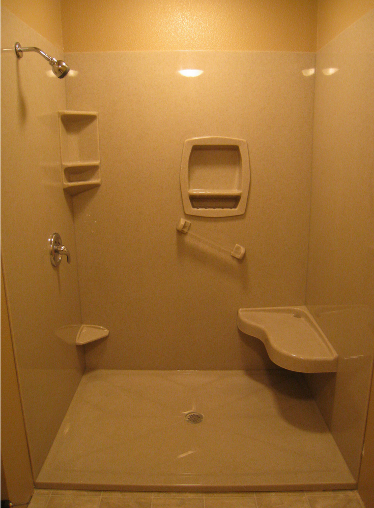 A foot stool recessed niche and bench seat in a solid surface shower | Innovate Building Solutions