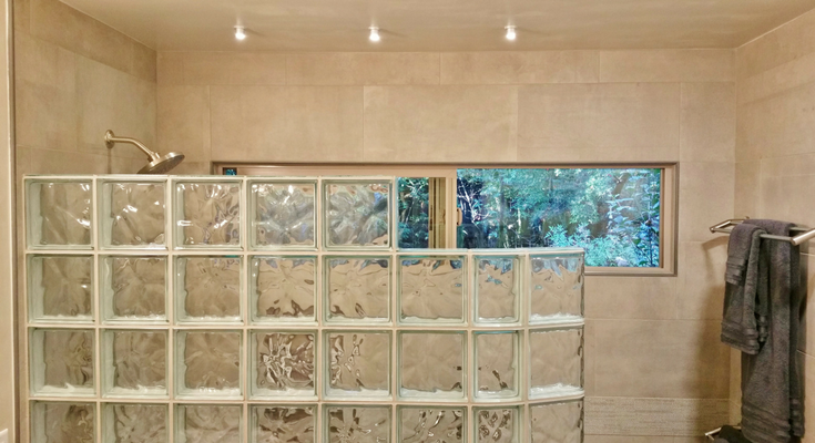 This clear transom window in bathroom remodel in Cazadero California with a curved glass block shower provides excellent views to the towering Redwood trees outside - Innovate Building Solutions