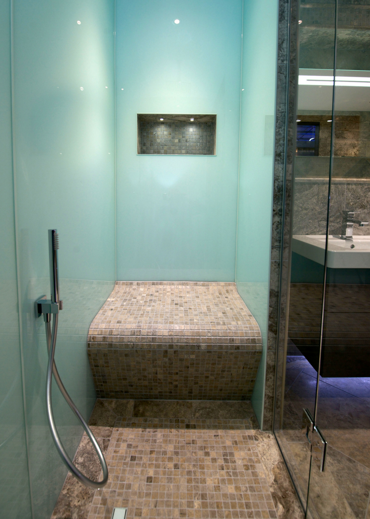 Glacier colored high gloss acrylic shower wall surround panels and ceramic tile shower pan | Innovate Building Solutions