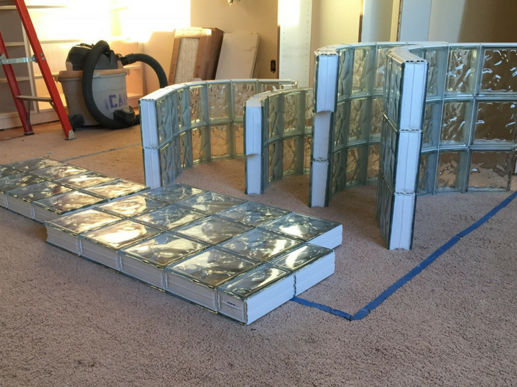 Prefabricated glass block sections for a curved walk in shower before installation - Innovate Building Solutions
