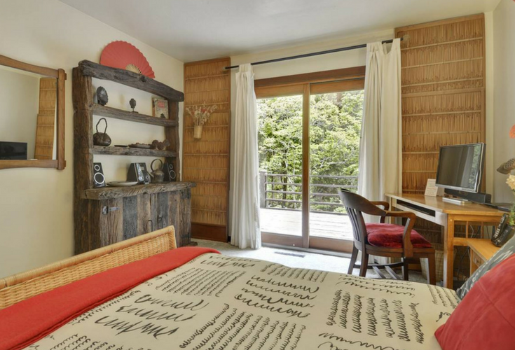 Rustic hand made dresser is a fun piece in this vacation home rental property called Sequoia Beach Dreamery in Cazadero California - Innovate Building Solutions