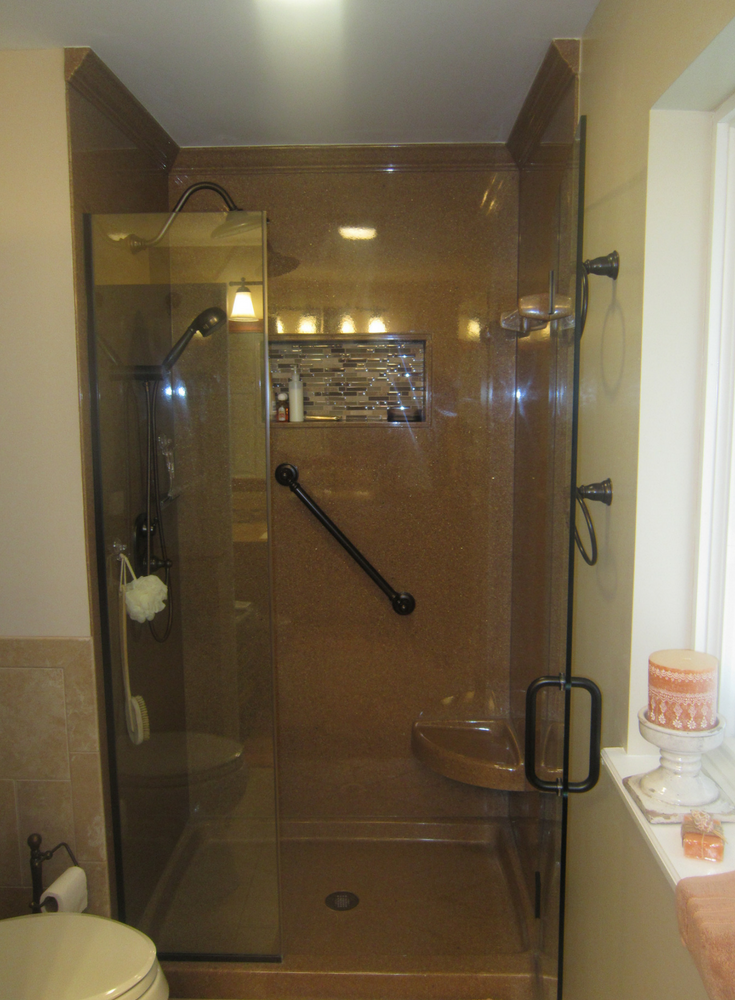 Solid surface crown molding in a stand up shower stall | Innovate Building Solutions