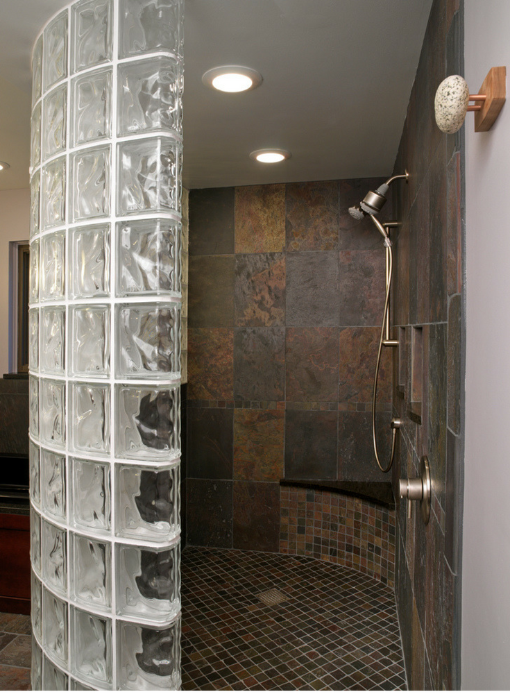 A curved glass block walk in shower with a tile shower pan | Innovate Building Solutions