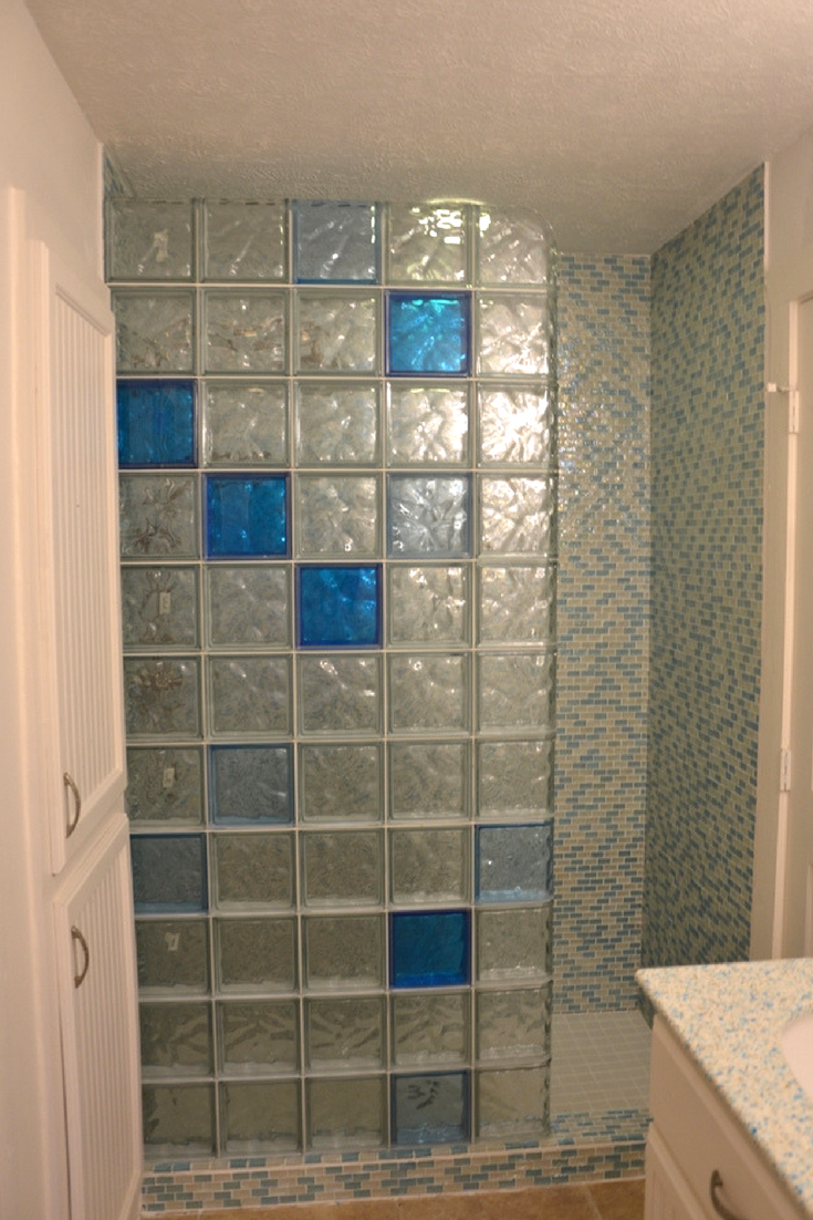 A glass block bathroom wall with finished edges on the top and side of the wall   Innovate Building Solutions