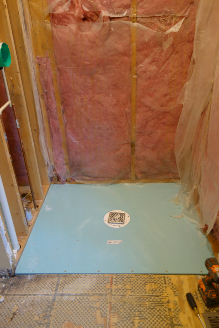 Bathroom remodeling project with one level shower pan for a wheelchair accessible bathroom | Innovate Building Solutions