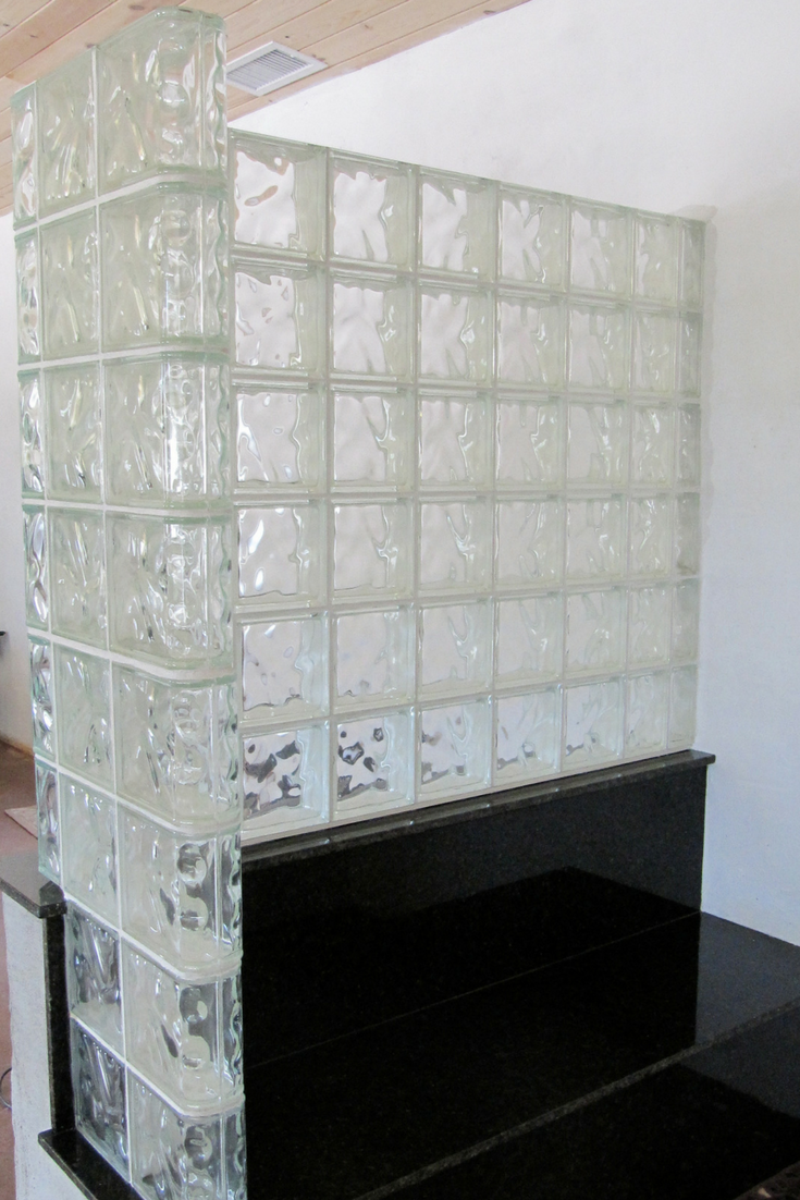 Glass block L shaped shower wall built on top of a bench seat knee wall | Innovate Building Solutions