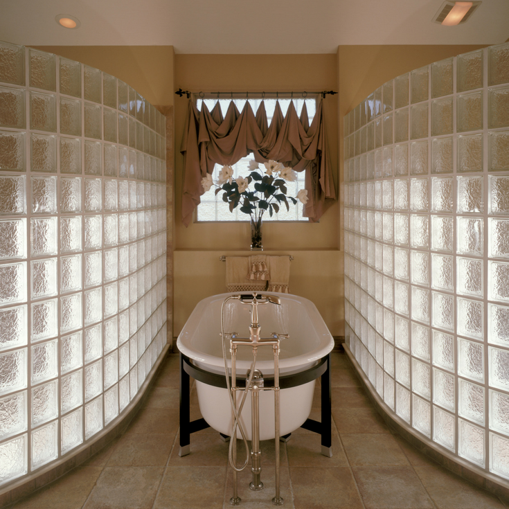 Gracefully curved glass block shower walls in a Tuscan style bathroom | Innovate Building Solutions