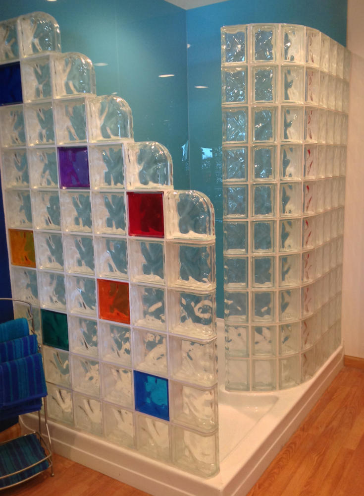 Step down and curved glass block shower walls with colored glass blocks   Innovate Building Solutions