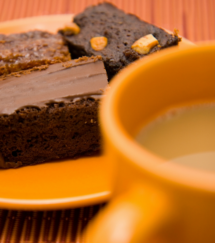 A fresh cup of coffee and brownies are the perfect way to get more out of your shower remodeling contractor | Innovate Building Solutions