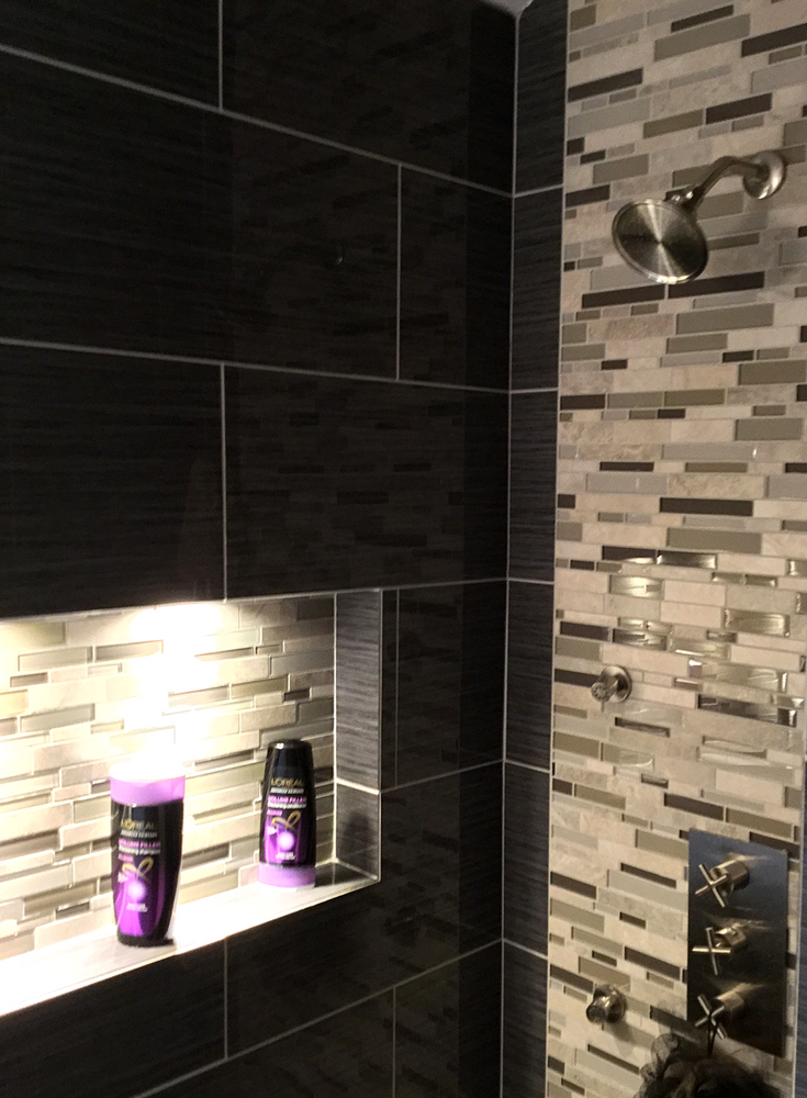 A bathroom recessed niche illuminated with LED lights in a contemporary Columbus Ohio bathroom | Innovate Building Solutions