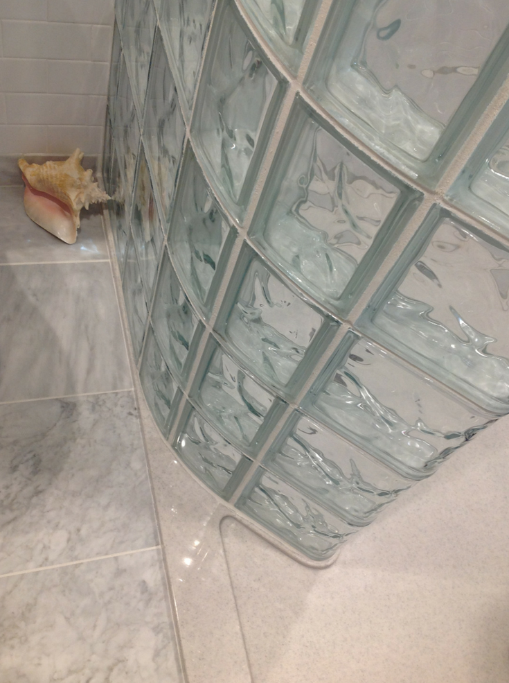 A curved glass block shower and a solid surface shower pan are durable and low maintenance. They are excellent products for your contractor to install because they won't have call backs. | Innovate Building Solutions