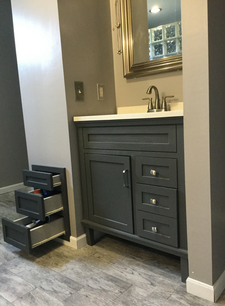 Custom drawers in a DIY bathroom remodel in Columbus Ohio to use space wisely in a drywall wall | Innovate Building Solutions