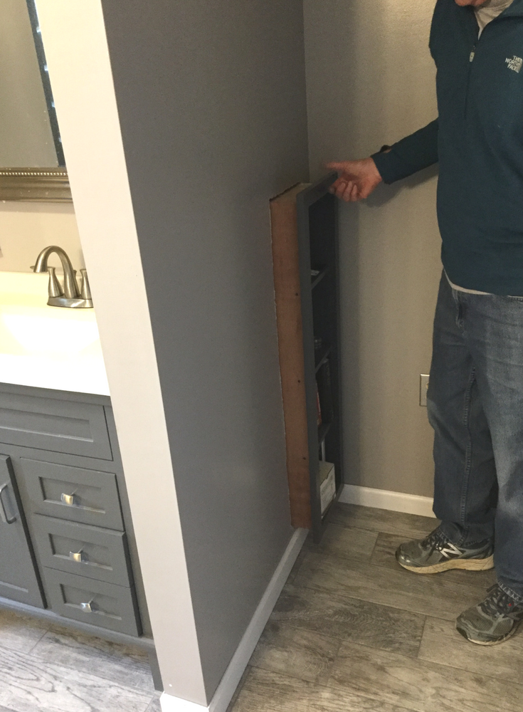 A custom made DIY pull out bathroom bookcase to allow access to the plumbing behind a bathroom vanity | Innovate Building Solutions