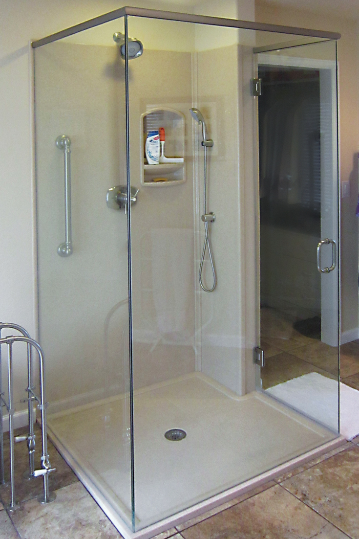 Custom solid surface shower pan and smooth wall panels in a luxury shower | Innovate Building Solutions