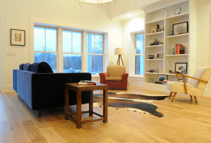 Mid-century modern living room design in a sustainable custom farmhouse in Connecticut | Innovate Building Solutions