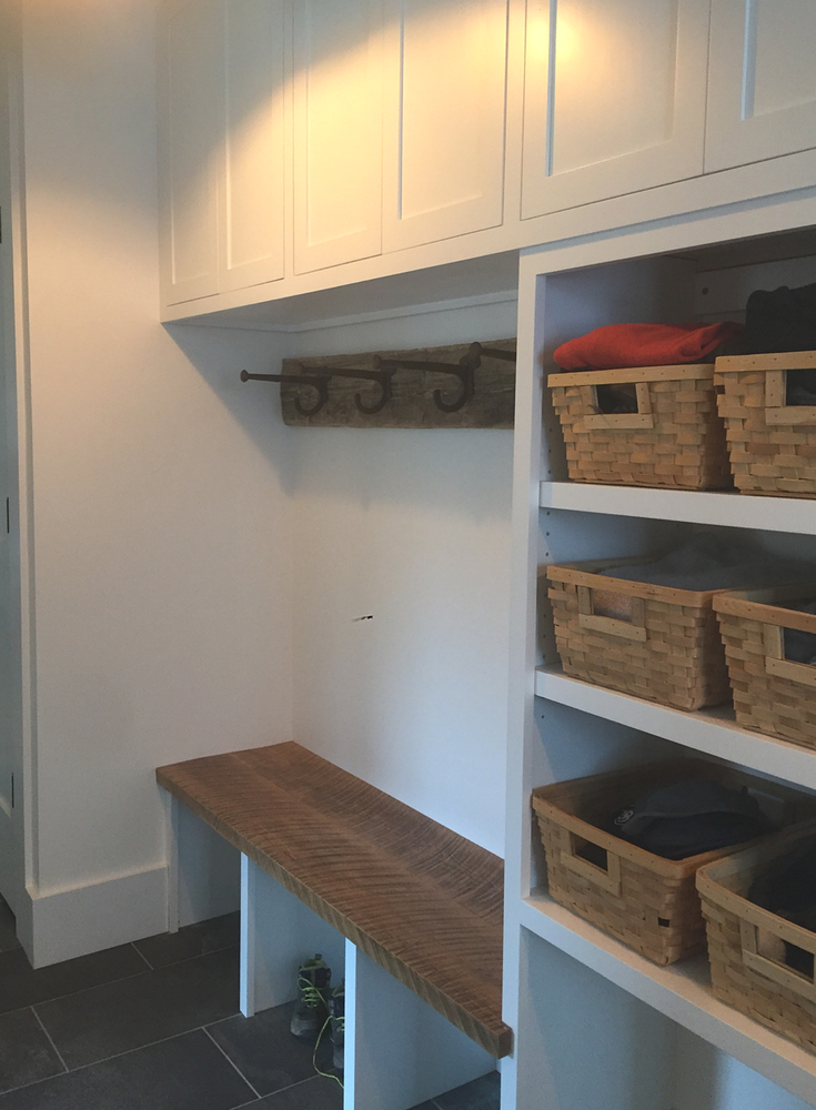 This organized mud room entryway provides efficient storage for a family in Connecticut in this sustainable energy efficient home. | Innovate Building Solutions & Innovate Home Org