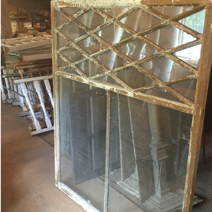 Ornate salvage window in a modern farmhouse before installation | Innovate Building Solutions
