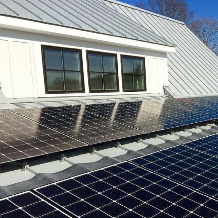 Silver gray metal roof in a sustainable energy efficient modern farmhouse in Connecticut | Innovate Building Solutions