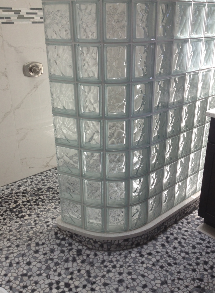Radius glass block premade shower wall installed on a ready for tile shower pan | Innovate Building Solutions
