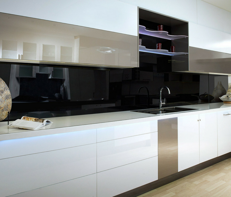 A black colored high gloss acrylic wall panel kitchen backsplash creates a sleek contemporary look | Innovate Building Solutions