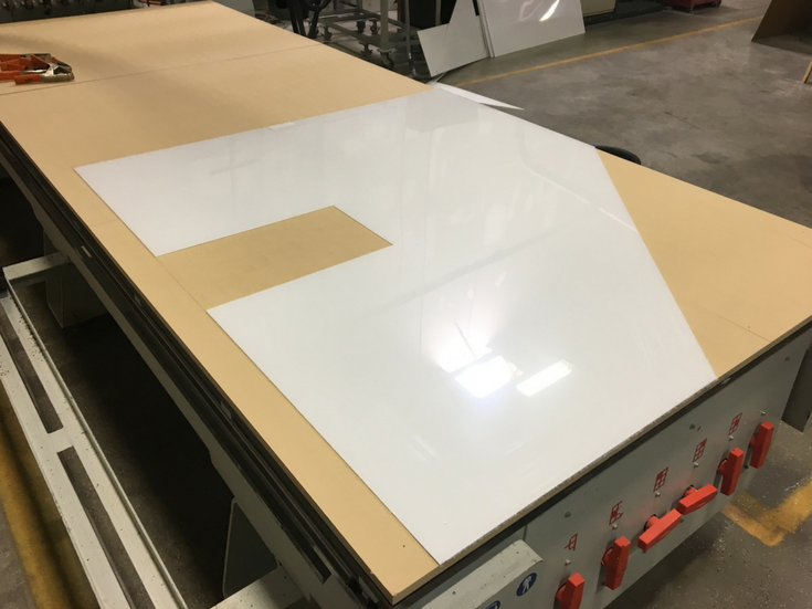 CNC laser cutting of high gloss wall panels for shower walls and kitchen backsplashes can save owners money and make DIY project simpler | Innovate Building Solutions