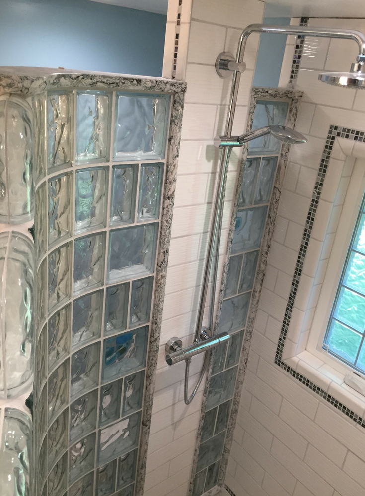 Decorative Cambria quartz sands color shower cap to finish off a curved walk in glass block wall | Innovate Building Solutions