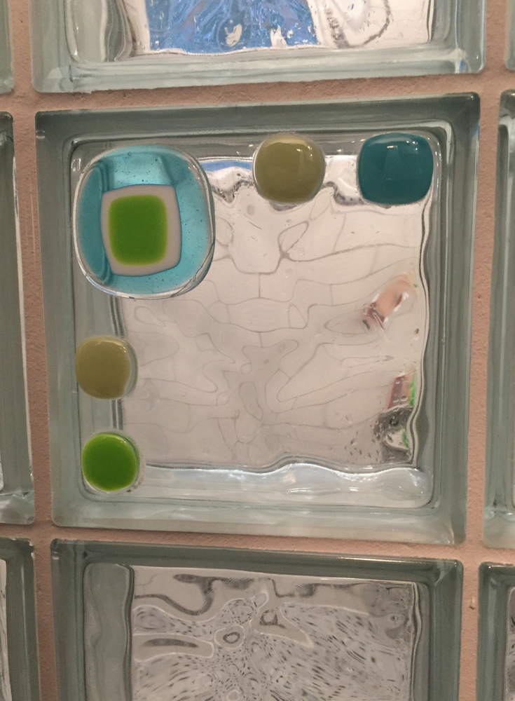 Decorative art glass tile blocks in a curved glass block shower | Innovate Building Solutions