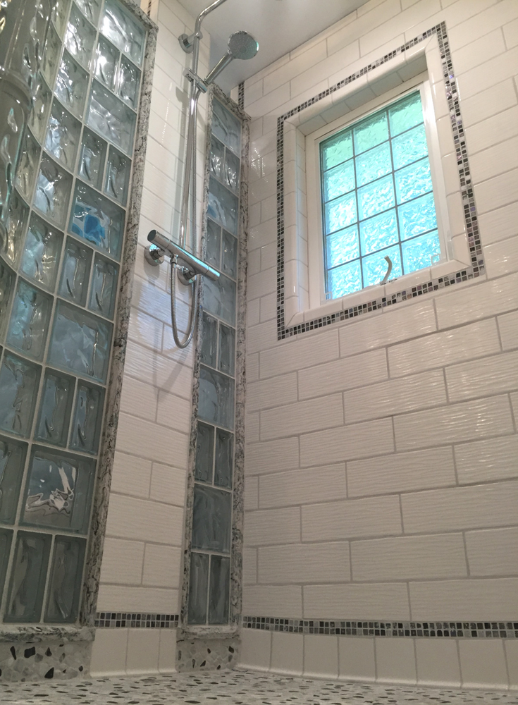 Decorative tile cove base in an upscale small bathroom shower remodeling project in New Jersey | Innovate Building Solutions