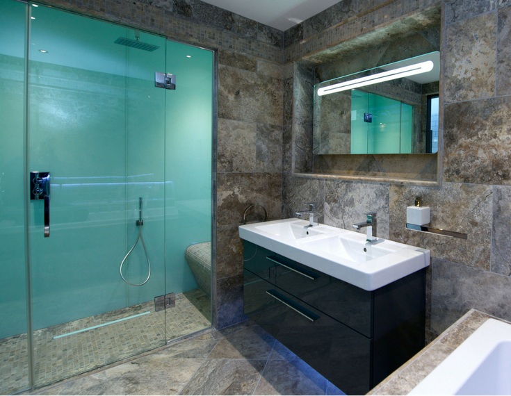 Glacier colored high gloss acrylic shower wall panels in bathroom remodel with a ceramic floor | Innovate Building Solutions