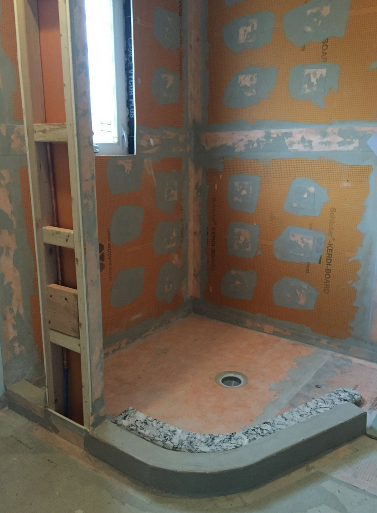 Kerdi tile waterproofing system installed before a glass block shower is installed in a New Jersey small bath remodeling project | Innovate Building Solutions