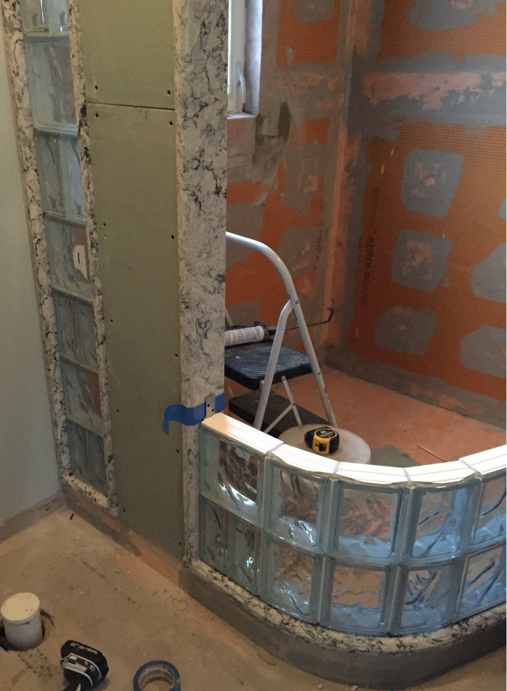 Prefabricated curved glass block shower wall sections in a small New Jersey shower | Innovate Building Solutions