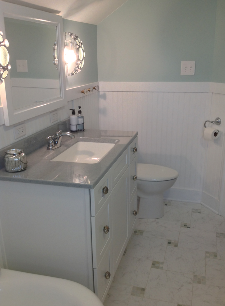 Solid Surface Bath Vanity Countertop With Shaker Cabinets | Innovate  Building Solutions
