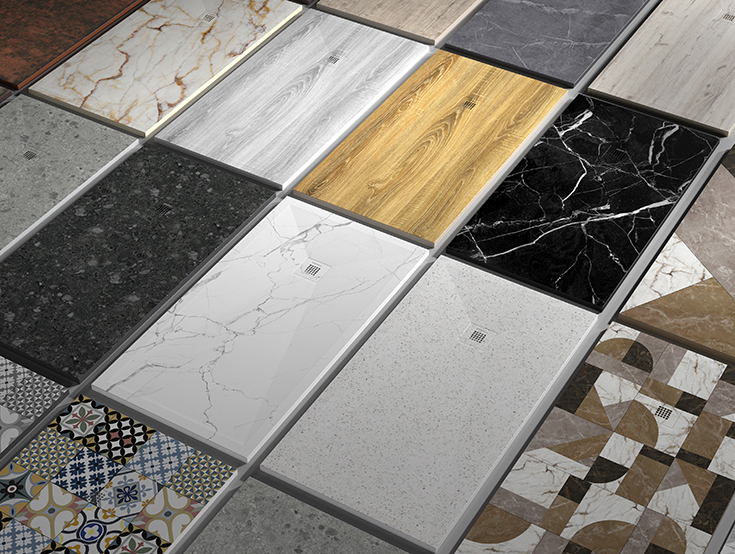 Assorted stone shower pans from Spain imported by Innovate Building Solutions