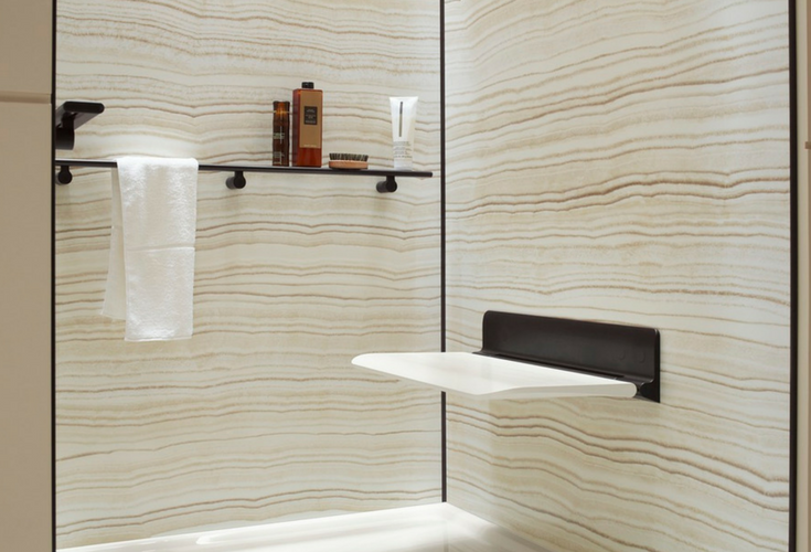 Grout free decorative shower wall panels with a fold down seat for an accessible shower - Innovate Building Solutions