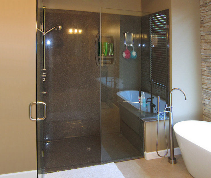 Low height solid surface shower floor pan with matching brown walls | Innovate Building Solutions
