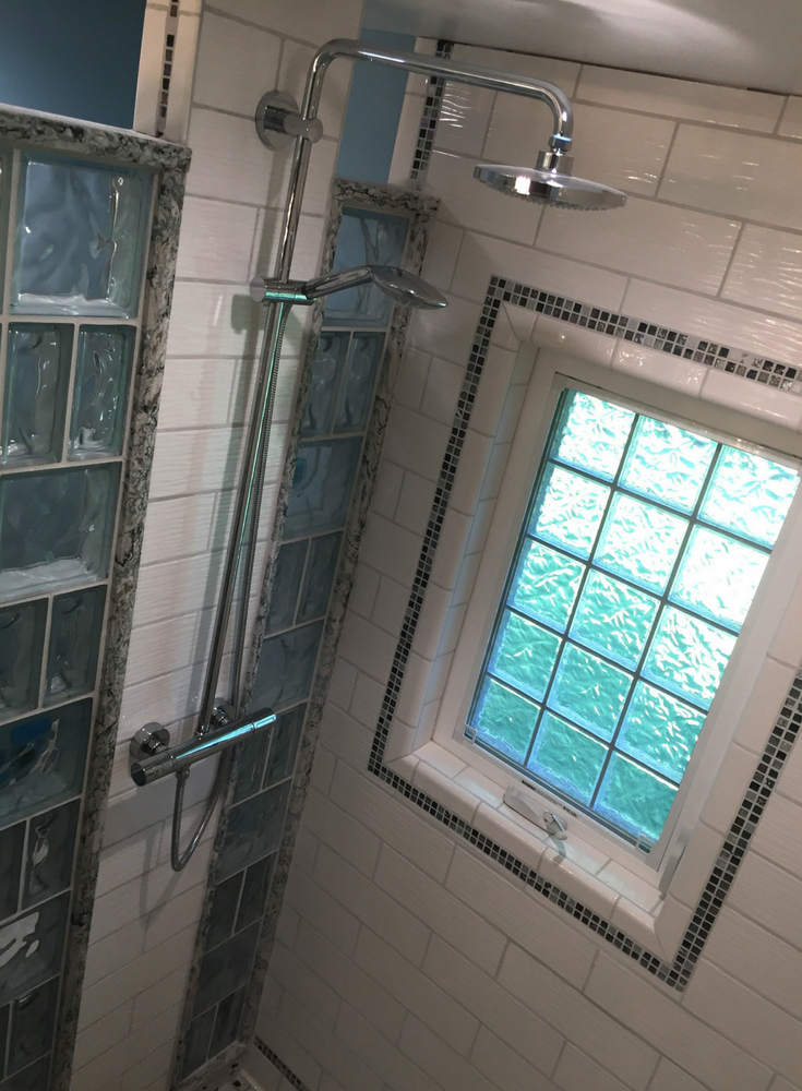 Casement style high privacy acrylic block window in a tile shower with decorative glass block walls | Innovate Building Solutions