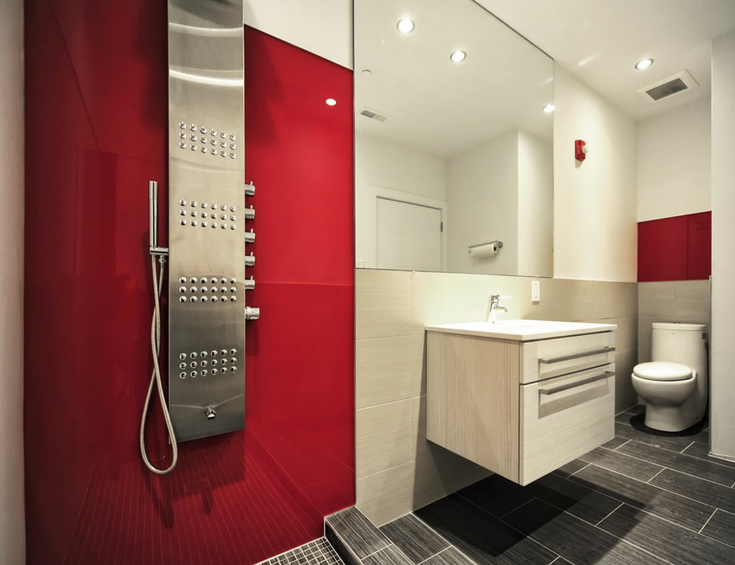 Contemporary fire-engine red high gloss panels with a Euro designed wall hung cabinet create a sleek bathroom space | Innovate Building Solutions