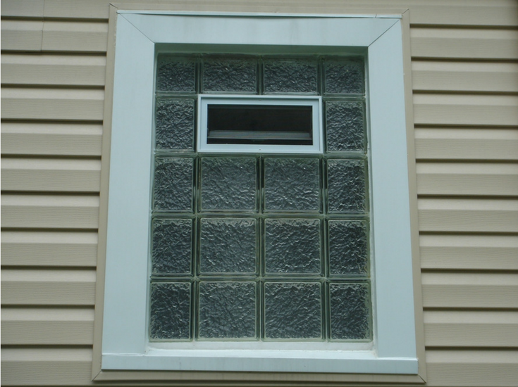 Protect all glass block bathroom window in a high privacy Icescapes pattern with an air vent | Innovate Building Solutions