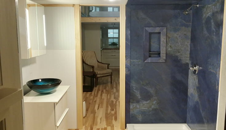 Decorative blue sodalite faux stone wall panels in a tiny home in North Carolina - Innovate Building Solutions