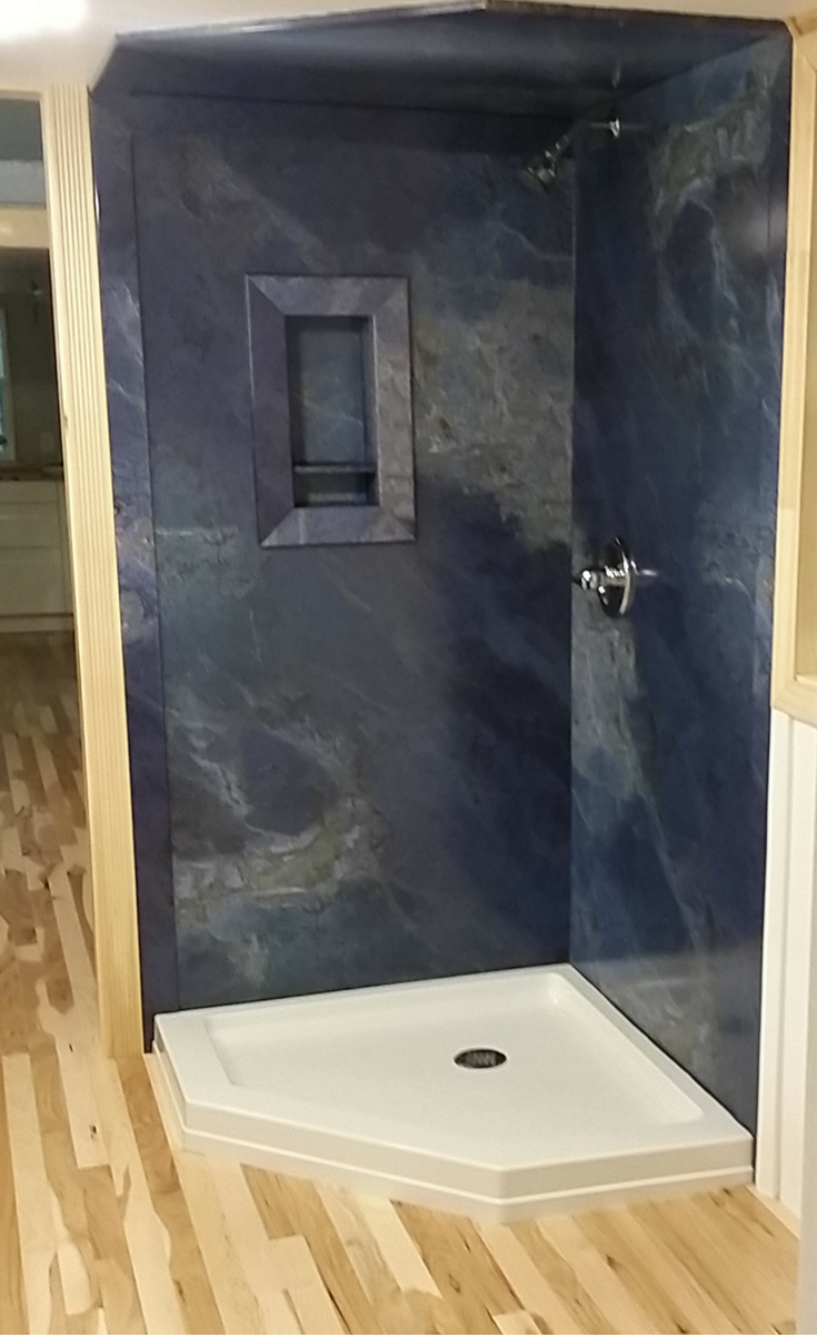 Faux granite shower wall panels in blue color with a ceiling panel - Innovate Building Solutions