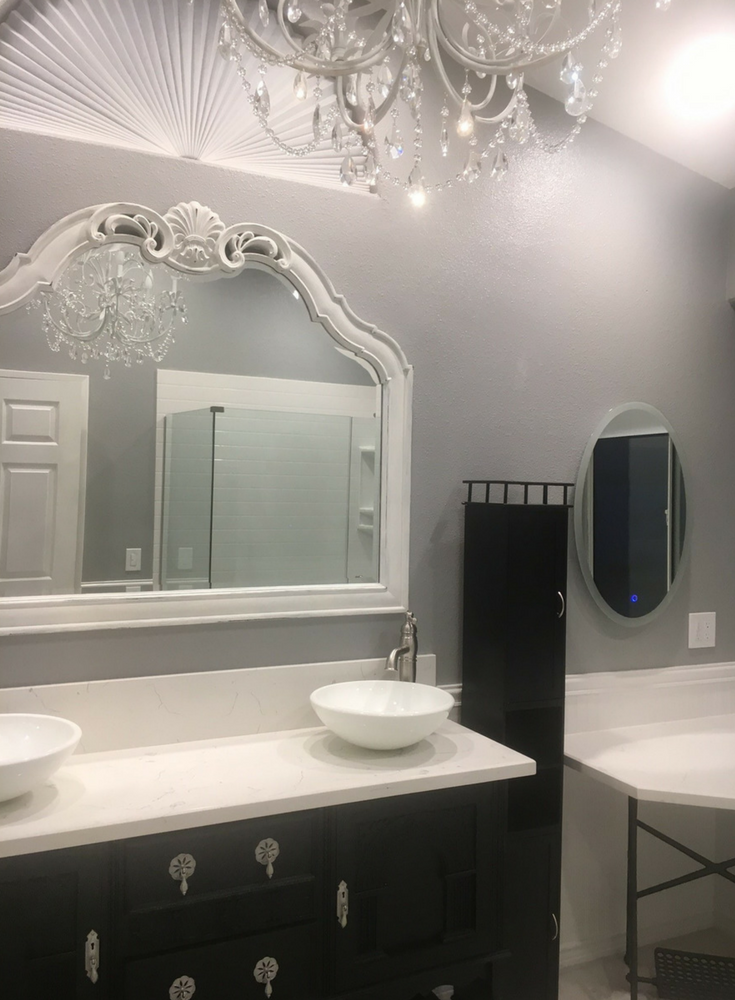 Femine styled vanity and chandelier in a luxury bathroom - Innovate Building Solutions