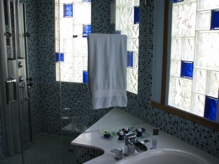 Glass block shower window with random colored glass blocks and sizes | Innovate Building Solutions