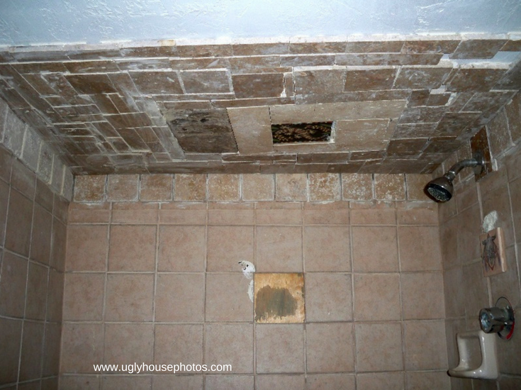 Really bad DIY tile shower with tiles falling off