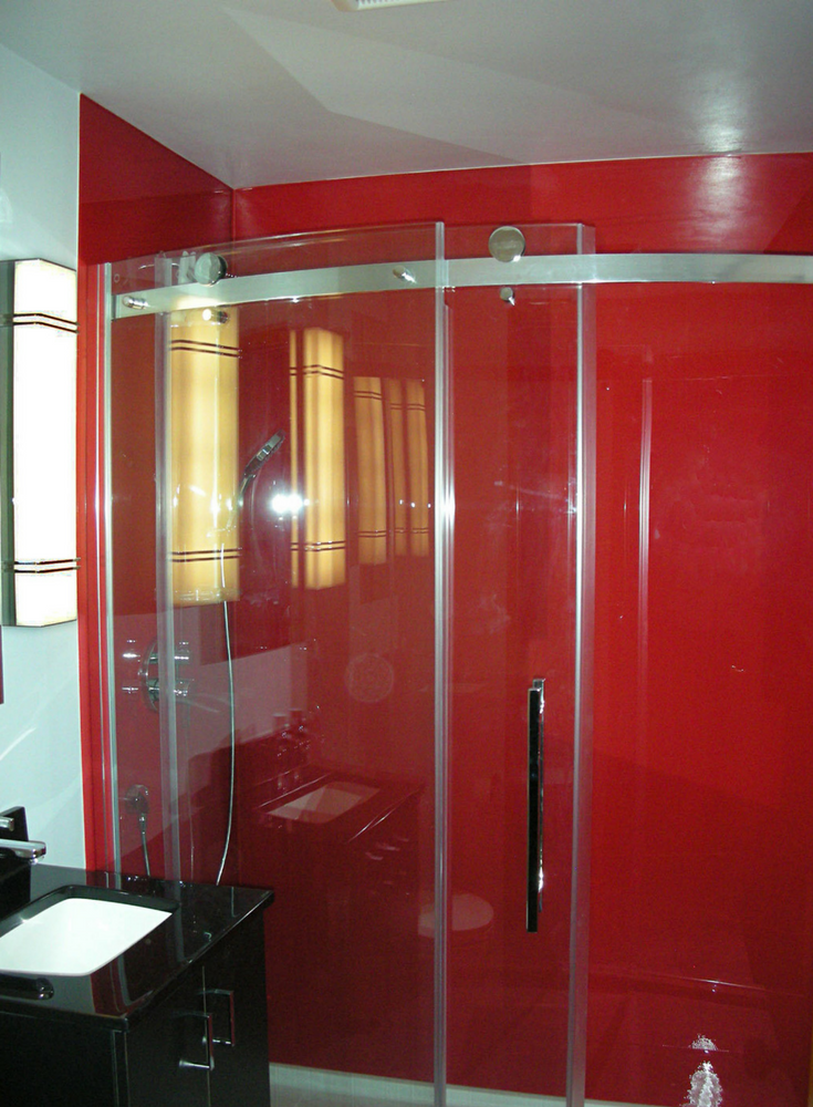 Red high gloss panels and curved frameless glass enclosure