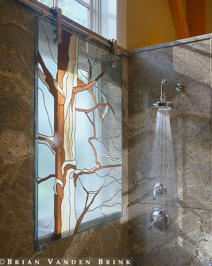 Stained glass shower window with a sliding operation | Innovate Building Solutions