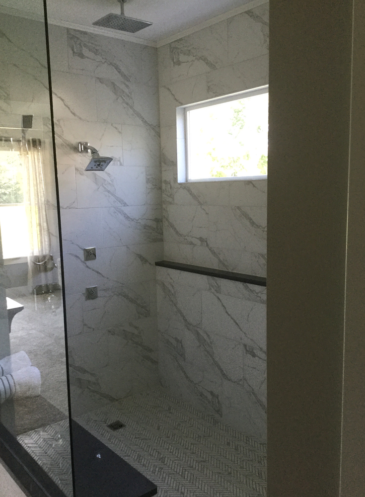 Transom window for better lighting in an aging in place roll in shower | Innovate Building Solutions
