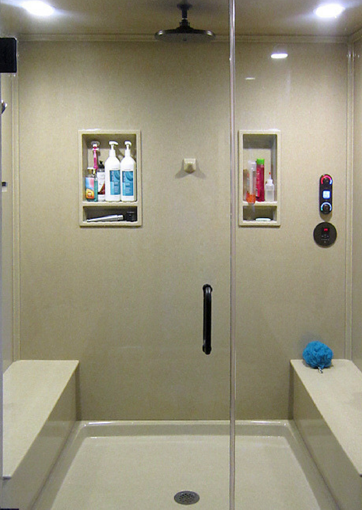 Custom sized solid surface shower wall panels and base and premade recessed niches in a kit | Innovate Building Solutions