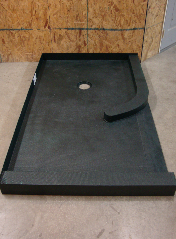 Lightweight ready for tile shower pan with a curved curb before installation | Innovate Building Solutions