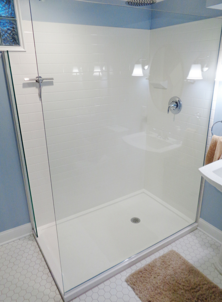 White Solid Surface Shower Base With A Faux Subway Tile Wall Panels |  Innovate Building Solutions